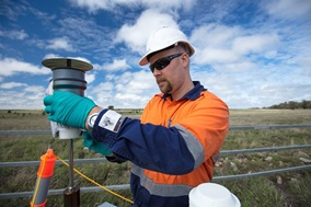Researcher checks air quality monitoring equipment adjacent to a coal seam gas well near Roma in Queensland's Surat Basin