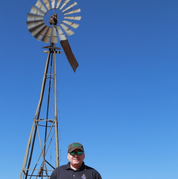 Kevin Ferguson in front of a windmill at the MRO