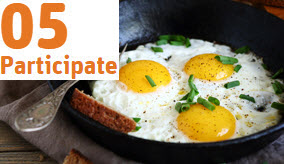 Fried eggs cooking in a frypan