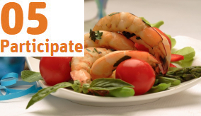 cooked prawns on a plate with salad