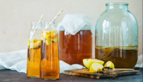 glasses and jars of kombucha