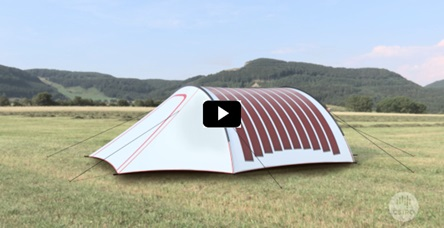 still image from a video showing a tent in a field with printed solar panels on it