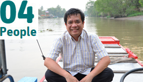 Dr Minh Nguyen on a boat in Vietnam