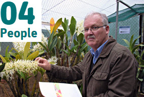 Mark Clements in greenhouse with orchids