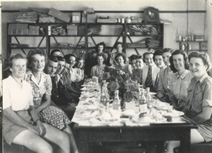 black and white photo of a group of mainly women sitting around a table