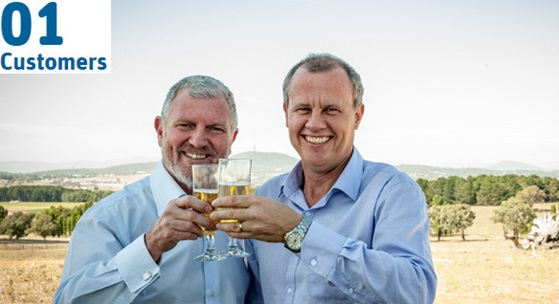 Two scientists raise glasses of kebari beer