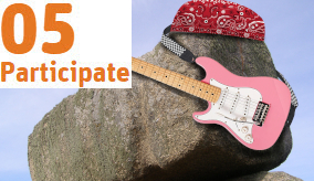 a rock with a bandana an a pink electric guitar on it